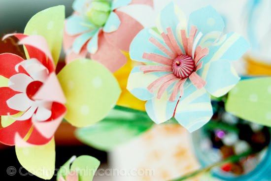 Handmade Paper Flowers - Easy Peasy: Since I like to save all my fabric and paper scraps, this is perfect way to use the paper scraps.